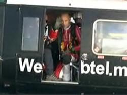 Rossy à bord de l'hélicoptère qui l'a secouru