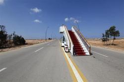 Escaliers d'embarquement sur une rue de sirte - Ph. Reuters